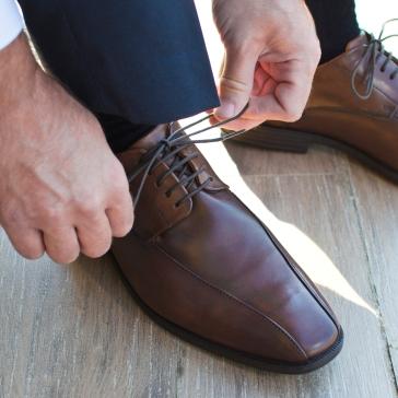 Gentleman preparing his shoes