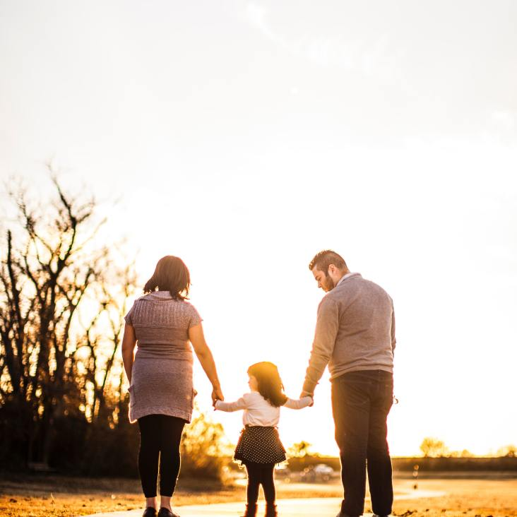 photo-of-family-standing-outdoors-during-golden-hour-3030090
