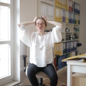 shocked-female-worker-in-modern-workplace-3791129
